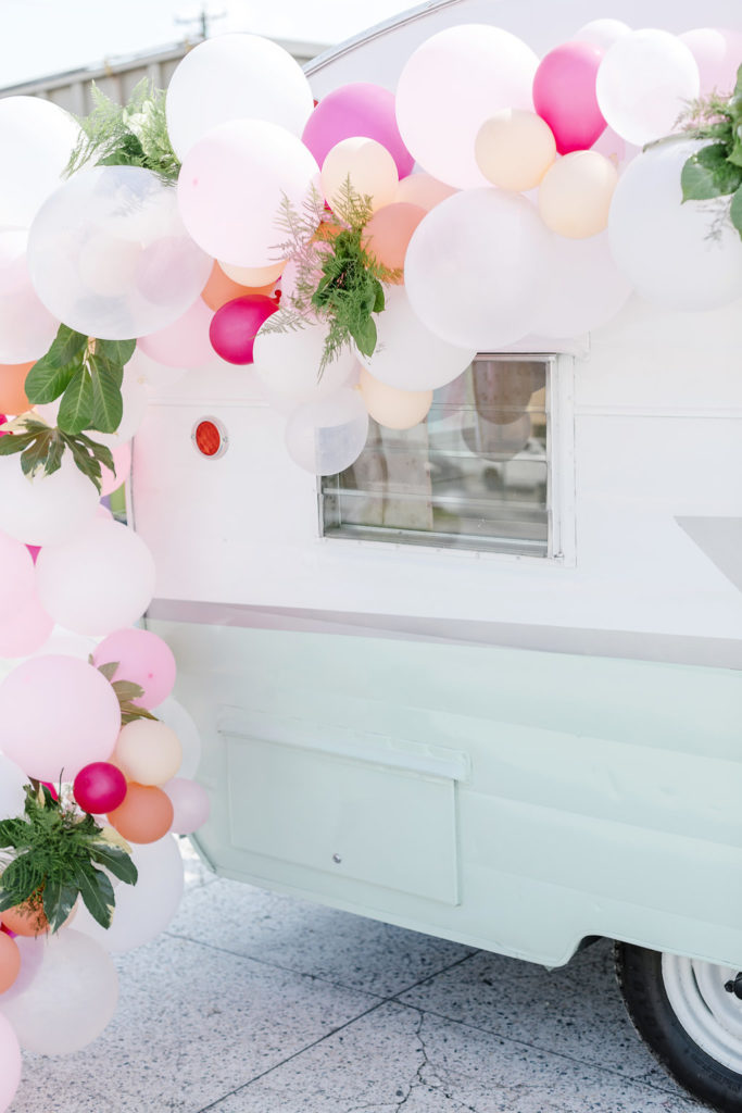 Pastel Balloon Arch with Flowers